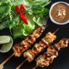 Satay chicken skewers